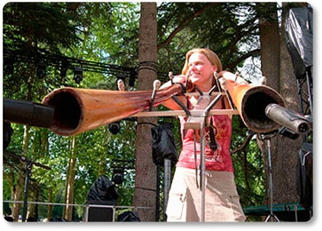 women playing didgeridoo